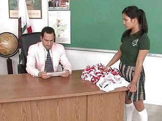 A Little Brunette Schoolgirl Blowing Her Mature Teacher For Good Grades
