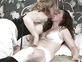 busty brunette lesbian having hot lesbian sex with her blonde girl